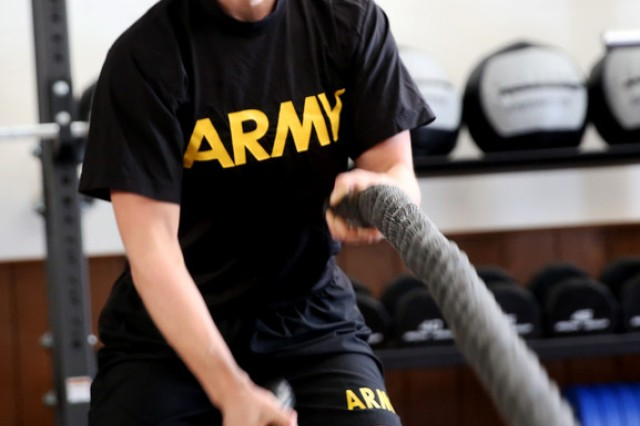 Army Capt. Breanna M. Owens, an intelligence officer assigned to the Joint Multinational Readiness Center in Hohenfels, Germany, demonstrates proper technique for working the ropes at the base's new functional fitness gym, March 5, 2018.