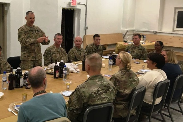 Maj. Jonathan Zagdanski, 361st Civil Affairs Brigade chaplain, explains the Passover Seder to attendees at Bagram Air Field, Afghanistan, March 30. (Courtesy photo)