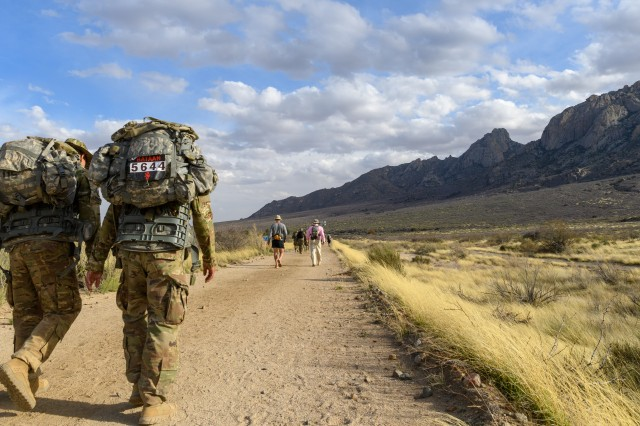 Service members, families and civilians participate in the 29th Annual Bataan Memorial Death March on March 25, 2018 at White Sands Missile Range, New Mexico. The Bataan Memorial Death March is a 26.2-mile run/ruck/walk event held annually to honor thousands of American and Filipino soldiers who defended the Philippines at the outbreak of World War II, particularly the 75,000 who surrendered to invading Japanese forces on April 9, 1942, and were marched by their captors over 60 miles through treacherous jungle terrain and into captivity.