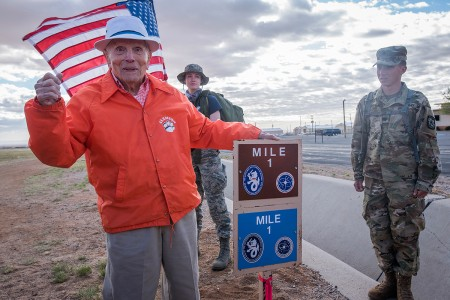 100-year-old Bataan Death March survivor Col. Ben Skardon, a beloved Clemson University alumnus and professor emeritus, celebrates arriving at the one-mile marker of the Bataan Memorial Death March at White Sands Missile Range, N.M., March 25, 2018. Skardon walked almost 7 miles to honor his brothers-in-arms who didn't return from the war.