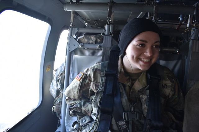 ROTC Cadet Camille Valenza, a platoon Sgt. in the Siena College Reserve Officer Training Corps(ROTC), rides in a UH-60 Black Hawk helicopter assigned to the 3rd Battalion 142nd Aviation in Latham, N.Y., on April 5, 2018. The ROTC cadets were conducting their monthly training in Burlington V.T.