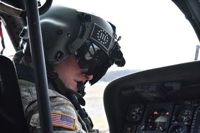 A N.Y. Army National Guard pilot assigned to 3rd Battalion, 142nd Aviation, prepares for a flight in a UH-60 Black Hawk Helicopter at Army Aviation Support Facility # 3 in Latham, N.Y., on April 5, 2018. The 3-142nd was flying Siena College students with the Reserve Officer Training Corps to Burlington, V.T. for their monthly training.