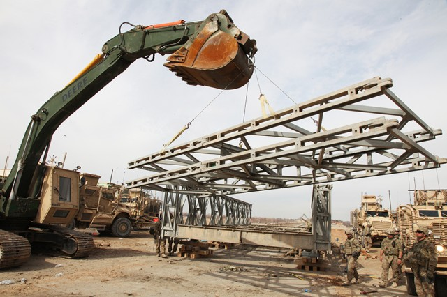 Business process re-engineering efforts are reforming Army enterprises, including logistics. The logistics pictured here are Soldiers of the 1438th Multi-Role Bridge Company, Missouri National Guard, disassembling an overbridge in Gereshk, Helmand province, Afghanistan.