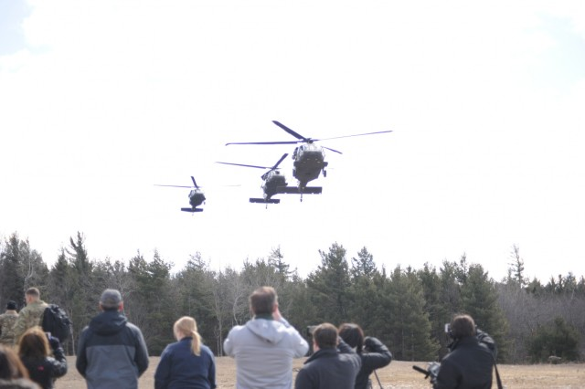 Local officials, members of the media and invited guests arrive at Fort Drum's Range 48 via UH-60 Black Hawks on April 9 to get a better perspective on the 10th Combat Aviation Brigade's Falcon's Peak training exercise.