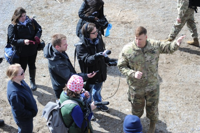 Col. Clair A. Gill, 10th Combat Aviation Brigade commander, speaks with members of the media on the first day of the unit's training exercise, Falcon's Peak, on April 9 at Fort Drum's Range 48.
