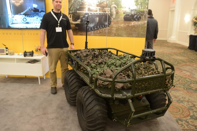 Retired Army 1st Sgt. Landon Jackson, a customer support manager with Roboteam, attends the NDIA-sponsored 2018 Ground Robotics Capabilities Conference & Exposition in Springfield, Va., April 10, 2018. Here, he displays his PROBOT, used for hauling supplies. The Army is using a number of these vehicles, he said.