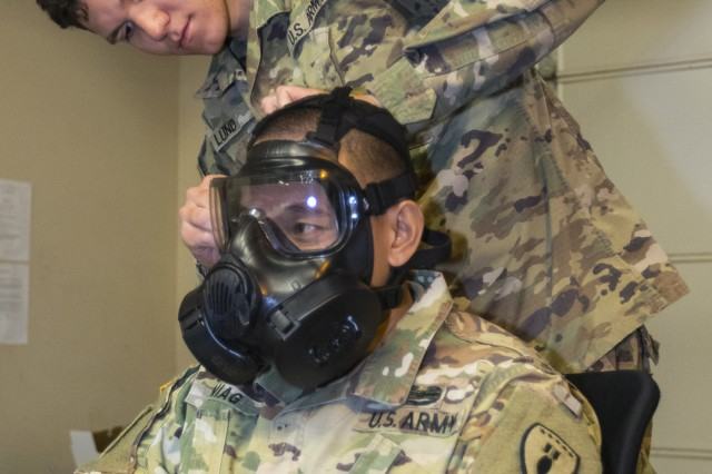 Private 1st Class Maxim Lund, a chemical, biological, radiological, nuclear specialist with 10th CBRN Company, 22nd CBRN Battalion, 48th Chemical Brigade, ensures the M50 Joint Service General Purpose Mask, known as the pro-mask, of Staff Sgt. Larry Buniag, a communications section noncommissioned officer in charge with Headquarters and Headquarters Detachment, 71st Ordnance Group (EOD), fits properly during the detachment's (CBRN) training week, Mar. 21-23, 2018, at various locations on Fort Carson, Colo. More than 50 other 71st EOD Soldiers participated in the training, which also served as an exercise in familiarization of current CBRN prevention techniques and procedures. (U.S. Army photo by Staff Sgt. Lance Pounds, 71st Ordnance Group (EOD), Public Affairs)