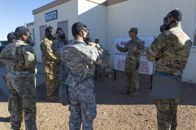 Staff Sgt. Dale Sipple (center), a chemical, biological, radiological, nuclear noncommissioned officer with 10th CBRN Company, 22nd CBRN Battalion, 48th Chemical Brigade, provides a group of Soldiers from Headquarters and Headquarters Detachment, 71st Ordnance Group (EOD), with a safety brief prior to entering the Range 72 Nuclear, Biological, Chemical Chamber, Mar. 23, 2018, at Fort Carson, Colo. Sipple and other Soldiers from 10th Chemical Co. aided in the training and familiarization of the M50 Joint Service General Purpose Mask, known as the pro-mask, to more than 50 71st EOD Soldiers during the detachment's week-long CBRN exercise. (U.S. Army photo by Staff Sgt. Lance Pounds, 71st Ordnance Group (EOD), Public Affairs)