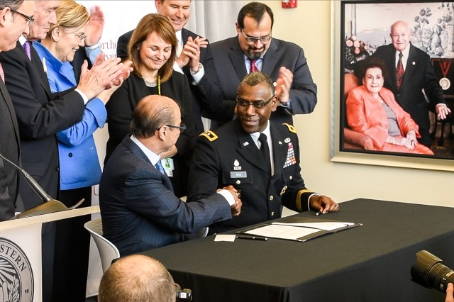U.S. Army Research, Development and Engineering Command, Maj. Gen. Cedric T. Wins (right) shakes hands with Northeastern University President Dr. Joseph E. Aoun after signing an agreement on a new collaboration in Burlington, Massachusetts, April 9, 2018.