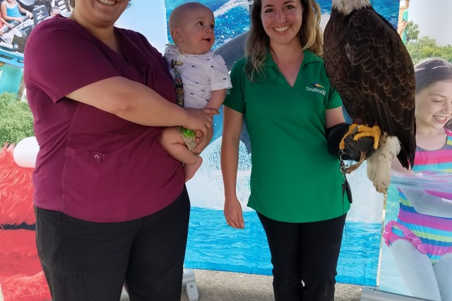 Katrina Campbell and her son Jonathan pose with a Bald Eagle during the Invincible Spirit Festival at Brooke Army Medical Center April 5, 2018. Thousands of BAMC patients, family members and staff enjoyed food, family-friendly activities and music by Stolen Silver and Sinise and the LT Dan Band.