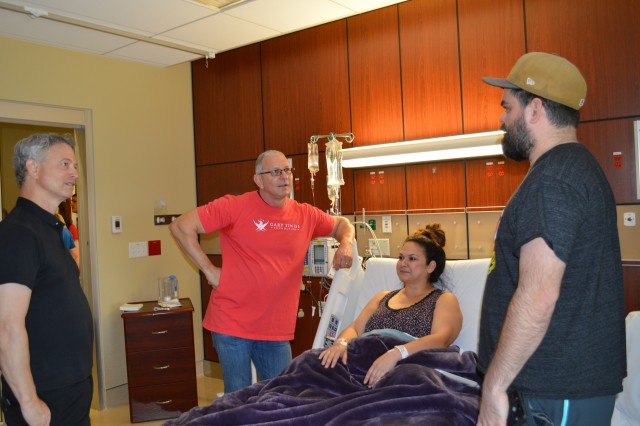Gary Sinise and Robert Irvine visit with Steven and Miriam Cromwell April 5, 2018 at Brooke Army Medical Center. Sinise and Irvine visited one-on-one with several wounded service members and inpatients before taking the stage at the 6th Invincible Spirit Festival at BAMC.