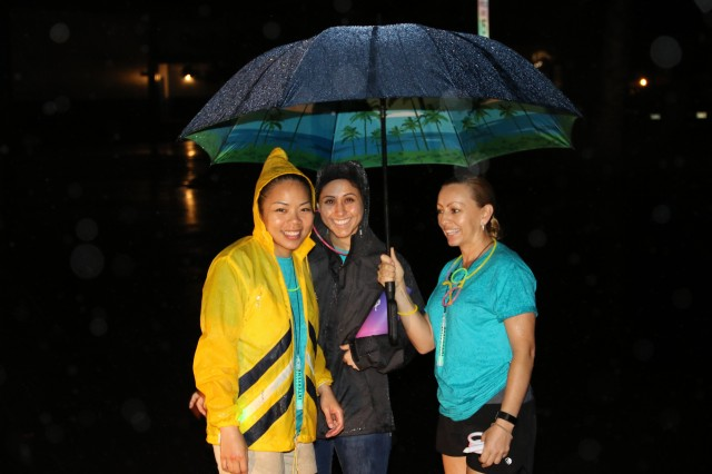 Volunteers at the 'Take Back the Night' 5k run provided glow gear and encouraged participants at the finish line on April 5, 2018. Despite the rain, dozens of volunteers cheered loudly for each and every participant as they completed the event on Wheeler Army Airfield.