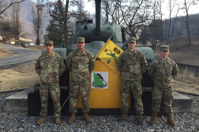 "The tank crew from the 3rd Battalion, 69th Armor Regiment, 1st Armored Brigade Combat Team, 3rd Infantry Division that will represent the ""Raider"" Brigade at the 2018 Sullivan Cup Competition at Fort Benning, GA. From left to right: Staff Sgt. Travis Connelly, Sgt. David Morales, Pfc. Thomas Deegan, and Pfc. Zachary Smith,"