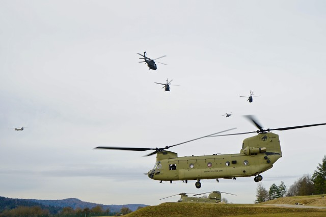 "CH-47 Chinook, HH-60 and UH-60 Black Hawk helicopter crews of the 1st Air Cavalry Brigade, 1st Cavalry Division take off Jan. 25 for their tactical assembly area inside the Hohenfels Training Area Airfield, Germany. The crews were part of Allied Spirit VIII, a multinational training exercise focusing on tactical interoperability and secure communications among NATO alliance members. ""The U.S. military is not ready for the threats we face today,"" said Paul Scharre, senior fellow at the Center for a New American Security. ""In a major power war, we will be required to innovate on timelines of months, not years. And we must have these processes of innovation in place today."""