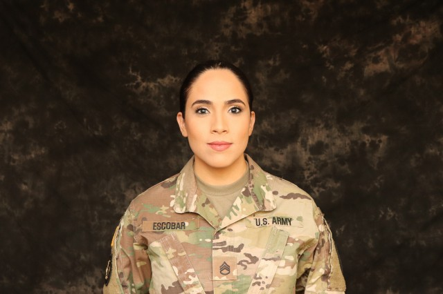 Texas Army National Guard Soldier and Mrs. Texas Galaxy, Staff Sergeant San Juanita Escobar poses for photos at Camp Mabry, in Austin, Texas, Mar. 30, 2018.