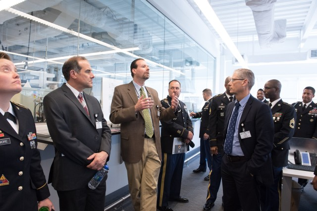 U.S. Army Research Laboratory officials and noncommissioned officers assigned to the lab tour facilities April 9, 2018, at the George J. Kostas Research Institute for Homeland Security at Northeastern University near Boston. The laboratory officially signed an agreement to start a new collaborative presence at the institute.