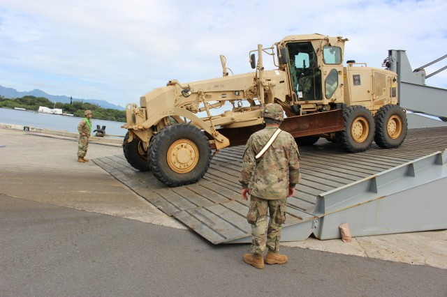 Soldiers offload an Army grader during 25th Infantry Division, 3rd Brigade Combat Team discharge operations  at Pearl Harbor on April 3.
