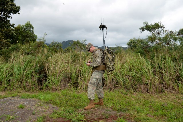 Sgt. Jessie Albert, an electronic warfare specialist assigned to 2nd Battalion, 35th Infantry Regiment, 3rd Brigade Combat Team, 25th Infantry Division, trains on the Wolfhound Radio Direction Finding System at Schofield Barracks, Hawaii, on April 11, 2018. The electronic warfare specialists use direction finding to gain a line-of-bearing to the target. (U.S. Army photo by Staff Sgt. Armando R. Limon, 3rd Brigade Combat Team, 25th Infantry Division)