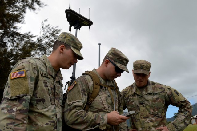 From left to write, Sgt. Orlando Varela, Sgt. Jessie Albert, and Staff Sgt. Brent Fulmer, electronic warfare specialists assigned to the 3rd Brigade Combat Team, 25th Infantry Division, train on the Wolfhound Radio Direction Finding System at Schofield Barracks, Hawaii, on April 11, 2018. The electronic warfare specialists use direction finding to gain a line-of-bearing to the target. (U.S. Army photo by Staff Sgt. Armando R. Limon, 3rd Brigade Combat Team, 25th Infantry Division)