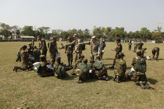 Bangladesh Army soldiers practice giving medical aid to role-players during a simulated mass casualty training event while multinational instructors observe them as part of Exercise Shanti Doot 4 in Bangladesh. Shanti Doot 4 is a multinational United Nations peacekeeping exercise with more than 1,000 participants from more than 30 countries designed to provide pre-deployment training to U.N. partner countries in preparation for real-world peacekeeping operations.