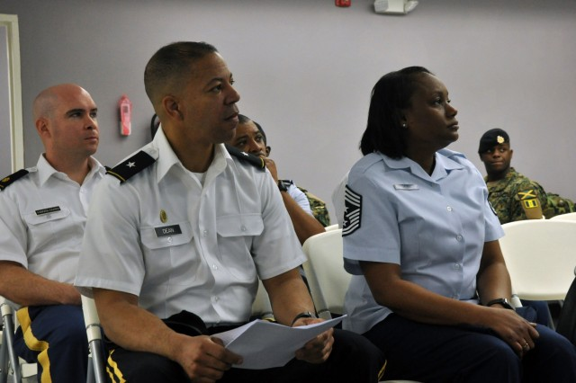 Maj. Jason Hanslovan, bilateral affairs officer, District of Columbia National Guard, sits in a briefing with key D.C. Guard leaders during a visit to a Jamaica Defence Force training facility on March 20, 2018, in Moneague, Jamaica. Hanslovan and D.C. Guard leaders visited the training facility during a key leader visit to Jamaica.