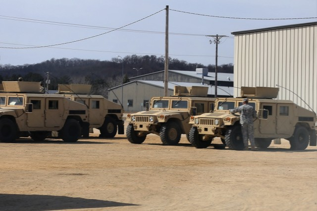 Vehicles used by Soldiers training in Operation Cold Steel II are parked on the cantonment area March 23, 2018, at Fort McCoy, Wis. Operation Cold Steel II is the Army Reserve's crew-served weapons qualification and validation exercise to ensure America's Army Reserve units and Soldiers are trained and ready to deploy on short notice as part of Ready Force X. Cold Steel II's Task Force Triad, hosted by the 416th Theater Engineer Command, will conduct training at Fort McCoy through May 31. More than 3,000 Soldiers are attending this mounted crew-served weapons qualification training. (U.S. Army Photo by Scott T. Sturkol, Public Affairs Office, Fort McCoy, Wis.)