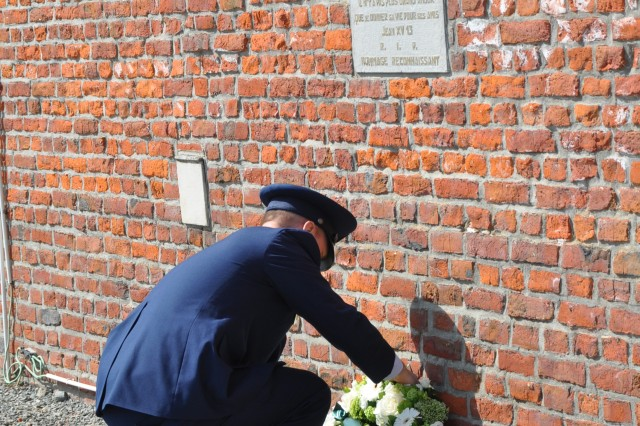 Air Force Lt. Col. Craig D. Lindstrom, commander of the 424th Air Base Squadron, pays his respects by laying a wreath beneath the Royal Flush commemorative plaque in Fouleng, Belgium,  April 10, 2018. Lindstrom and his airmen joined city officials and the local community in remembering the victims of the 1944 crash.