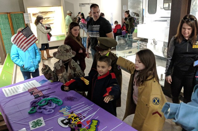 Children try on historical military uniforms April 7 during a Month of the Military Child event at the 10th Mountain Division (LI) and Fort Drum Museum.