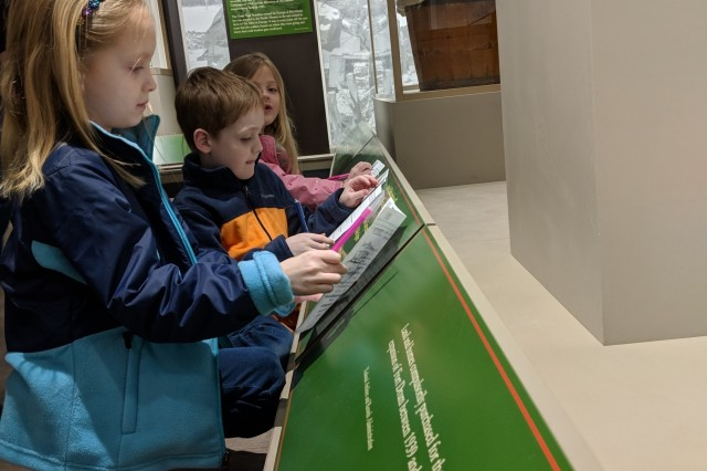 Children search the 10th Mountain Division and Fort Drum Museum for particular items in the displays during a scavenger hunt April 7 at the Month of the Military Child event.