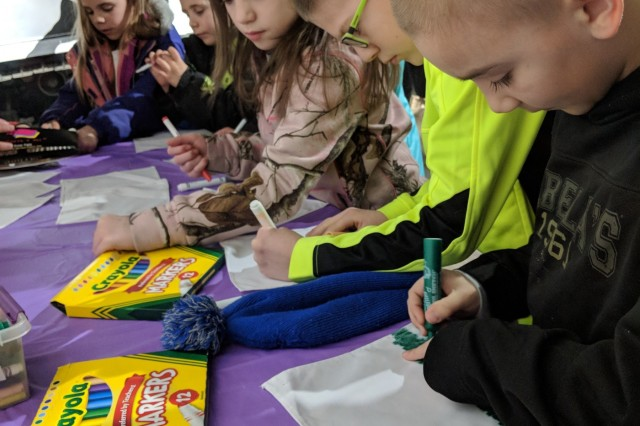 Among the activities celebrating military children, attendees designed patches that were sewn together for a special Month of the Military Child quilt and displayed at the 10th Mountain Division and Fort Drum Museum.