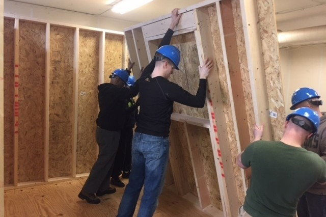 Six transitioning Soldiers at Fort Drum, New York, participate in a hands-on project April 2 at the conclusion of the six-week Construction Craft Laborer Course. This was the latest employment skills training program offered at the Fort Drum Soldier For Life-Transition Assistance Program. (Photo by Chris Gray)