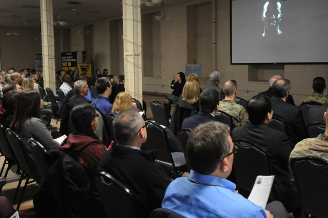 Soldiers, Army civilians and representatives of local agencies watch a poem by Chief Warrant Officer 3 Edward Wilson, during the National Sexual Assault Awareness and Prevention Month Kickoff, April 2 at Heritage Hall, Rock Island Arsenal, Illinois. Wilson gave a riveting interpretation of how important it is for everyone to take a stand against sexual harassment and sexual assault. (U.S. Army photo by Sgt. 1st Class Meillettis Patton, ASC Public Affairs)