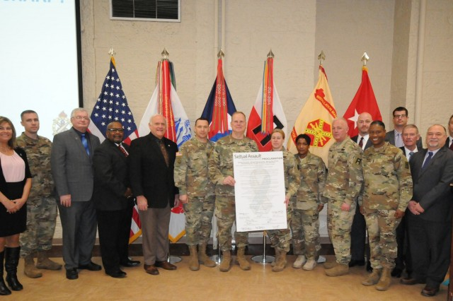 Maj. Gen. Duane Gamble, commanding general, U.S. Army Sustainment Command and senior mission commander at Rock Island Arsenal, stands with installation commanders, local leaders and officials after signing the Sexual Assault Awareness and Prevention Month Proclamation, April 2 at Heritage Hall, RIA, Illinois. (U.S. Army photo by Sgt. 1st Class Meillettis Patton, ASC Public Affairs)