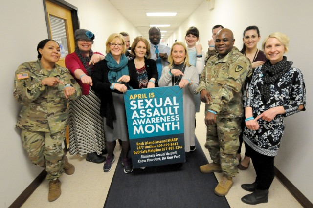 "Army Sustainment Command Soldiers and civilians gather April 3 for a ""Teal Tuesday"" photo at the Rock Island Arsenal Garrison SHARP office, to show their support for the program, RIA, Illinois. (U.S. Army photo by Sgt. 1st Class Meillettis Patton, ASC Public Affairs)"