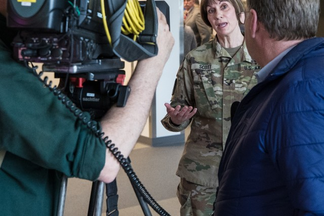 Col. Beverly Scott, director of the Intrepid Spirit Center, explains how the new center offers both traditional and nontraditional therapies during interviews with Seattle media at the Intrepid Spirit Center at Joint Base Lewis-McChord, Wash., on April 5.
