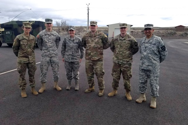 Pvt. Gracie Hilinski, Spc. Brandon Issacson, Sgt. Richard Schutt and Spc. Mitchell Potter, medical section, Headquarters Battery, 2nd Battalion, 146th Field Artillery Regiment stand with Command Chief Master Sgt. Trish Almond, State Senior Enlisted Leader, Washington National Guard and Command Sgt. Maj. Alfonso Cadena, Command Sgt Maj., 81st Stryker Brigade Combat Team. The four soldiers actions on April 6, 2018 saved a young girls life near North Bend, Wash.