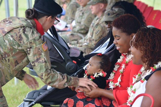 Family members receive leis during the Change of Responsibility ceremony of Command Sgt. Maj. Patrickson Toussaint to Command Sgt. Maj. Chad Blansett as the enlisted advisor for the 130th Engineer Brigade.