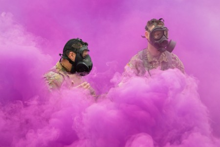 Soldiers of the 19th Special Forces Group demonstrate good seals on their gas masks during skill testing lanes during the Utah state-level Best Warrior Competition at Camp Williams, Utah, April 7, 2018.