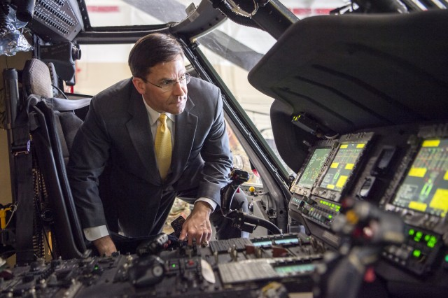 Secretary of the Army Dr. Mark T. Esper takes a look at a helicopter during his visit to Fort Knox on April 13, 2018.
