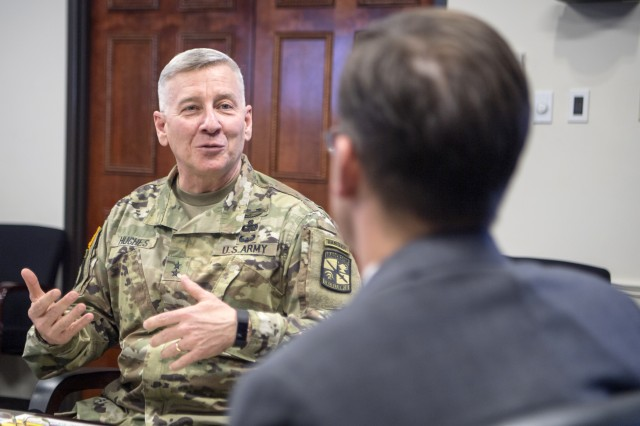 Maj. Gen. Christopher Hughes, commanding general of U.S. Army Cadet Command and Fort Knox, talks with Esper about the mission and personnel at Fort Knox, April 13, 2018.
