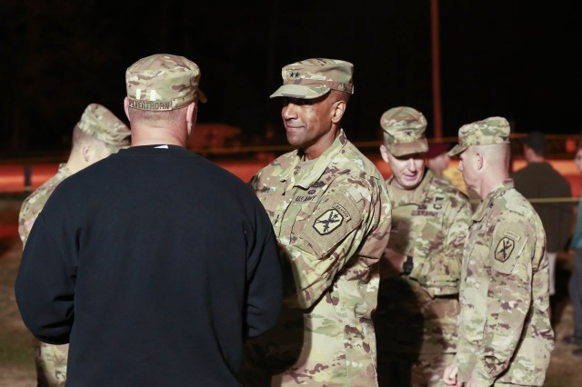 FORT BENNING, Ga. (April 13, 2018) -- Maj. Gen. Gary M. Brito, center, commanding general of the Maneuver Center of Excellence and Fort Benning, attends the opening of the 2018 Best Ranger Competition. On the first day of the 2018 Best Ranger Competition, 51 teams of two Ranger-qualified U.S. military service members took on several events to test their physical endurance, mental acumen, and technical and tactical skills. The 35th David E. Grange Jr. Best Ranger Competition, an annual competition organized by the Airborne and Ranger Training Battalion, is set to determine the most elite Ranger-qualified two-athlete team of the Armed Services April 13 through 15 at Fort Benning, Georgia. (U.S. Army photo by Markeith Horace, Maneuver Center of Excellence, Fort Benning Public Affairs Office)