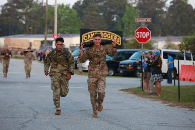FORT BENNING, Ga. (April 13, 2018) -- Spc. Jesus Delgado, left, and 1st Lt. Matthew Slocum, right, Team 11 from the 10th Mountain Division, complete the mass start run at Camp Rogers. On the first day of the 2018 Best Ranger Competition, 51 teams of two Ranger-qualified U.S. military service members took on several events to test their physical endurance, mental acumen, and technical and tactical skills. The 35th David E. Grange Jr. Best Ranger Competition, an annual competition organized by the Airborne and Ranger Training Battalion, is set to determine the most elite Ranger-qualified two-athlete team of the Armed Services April 13 through 15 at Fort Benning, Georgia. (U.S. Army photo by Markeith Horace, Maneuver Center of Excellence, Fort Benning Public Affairs Office)