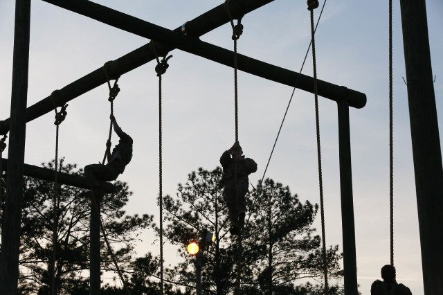 FORT BENNING, Ga. (April 13, 2018) -- Competitors climb the ropes at Malvesti Obstacle Course. On the first day of the 2018 Best Ranger Competition, 51 teams of two Ranger-qualified U.S. military service members took on several events to test their physical endurance, mental acumen, and technical and tactical skills. The 35th David E. Grange Jr. Best Ranger Competition, an annual competition organized by the Airborne and Ranger Training Battalion, is set to determine the most elite Ranger-qualified two-athlete team of the Armed Services April 13 through 15 at Fort Benning, Georgia. (U.S. Army photo by Markeith Horace, Maneuver Center of Excellence, Fort Benning Public Affairs Office)