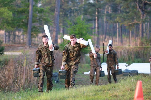 FORT BENNING, Ga. (April 13, 2018) -- First Lt. Corbin Davey, left, and 1st Lt. Tom White, right, Team 5 from 4th Infantry Division, carry slosh pipes. On the first day of the 2018 Best Ranger Competition, 51 teams of two Ranger-qualified U.S. military service members took on several events to test their physical endurance, mental acumen, and technical and tactical skills. The 35th David E. Grange Jr. Best Ranger Competition, an annual competition organized by the Airborne and Ranger Training Battalion, is set to determine the most elite Ranger-qualified two-athlete team of the Armed Services April 13 through 15 at Fort Benning, Georgia. (U.S. Army photo by Markeith Horace, Maneuver Center of Excellence, Fort Benning Public Affairs Office)