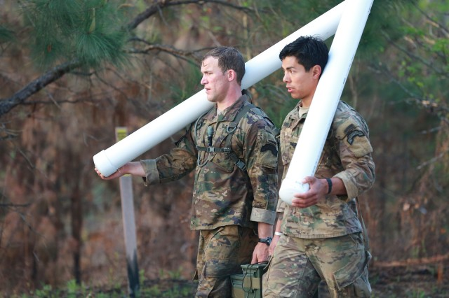 FORT BENNING, Ga. (April 13, 2018) -- First Lt. Jeremy Dettmer, left, and Cpl. Tyler Taormina, right, of Team 33 from the 75th Ranger Regiment, carry slosh pipes. On the first day of the 2018 Best Ranger Competition, 51 teams of two Ranger-qualified U.S. military service members took on several events to test their physical endurance, mental acumen, and technical and tactical skills. The 35th David E. Grange Jr. Best Ranger Competition, an annual competition organized by the Airborne and Ranger Training Battalion, is set to determine the most elite Ranger-qualified two-athlete team of the Armed Services April 13 through 15 at Fort Benning, Georgia. (U.S. Army photo by Markeith Horace, Maneuver Center of Excellence, Fort Benning Public Affairs Office)