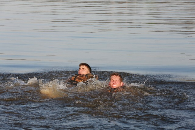 FORT BENNING, Ga. (April 13, 2018) -- Capt. Mark Gaudet, left, and 1st Lt. Deaven Miller, right, of Team 1 from the 1st Infantry Division, swim in Victory Pond. On the first day of the 2018 Best Ranger Competition, 51 teams of two Ranger-qualified U.S. military service members took on several events to test their physical endurance, mental acumen, and technical and tactical skills. The 35th David E. Grange Jr. Best Ranger Competition, an annual competition organized by the Airborne and Ranger Training Battalion, is set to determine the most elite Ranger-qualified two-athlete team of the Armed Services April 13 through 15 at Fort Benning, Georgia. (U.S. Army photo by Markeith Horace, Maneuver Center of Excellence, Fort Benning Public Affairs Office)