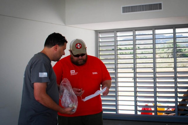 Victor Otero and Jess Cary, U.S. Army Corps of Engineers Task Force Power Restoration real estate specialists, review lease documents April 9 in Caguas, Puerto Rico at the Montaña area office. Caguas, Puerto Rico was one of the hardest hit areas of the island, after Hurricane Maria made landfall September 2017.