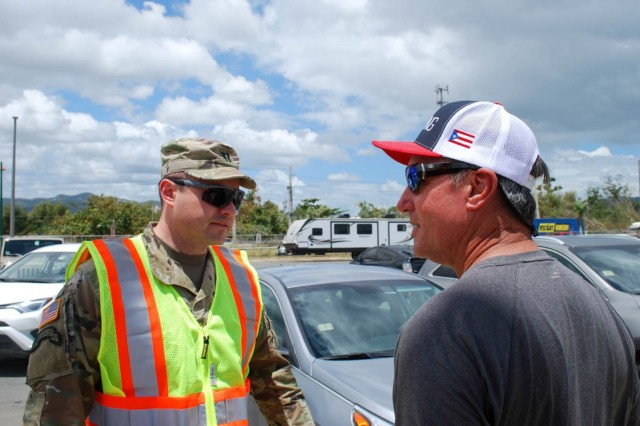 Capt. Lamar Cantelou, U.S. Army Corps of Engineers Task Force Power Restoration deputy area engineer, meets with PowerSecure, Inc. contractors at the Montaña area office April 9 in Caguas, Puerto Rico. Caguas, Puerto Rico was one of the hardest hit areas of the island, after Hurricane Maria made landfall September 2017. USACE remains committed to make maximum contributions towards final emergency restoration for the people of Puerto Rico and to finish strong.