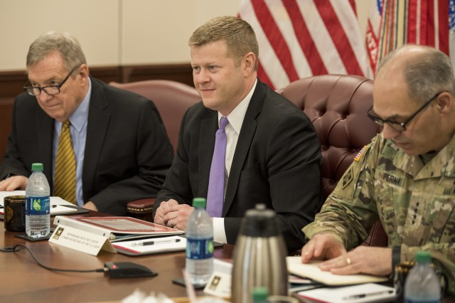 Under Secretary of the Army Ryan D. McCarthy (center) along with U.S. Sen. Dick Durbin of Illinois (left) learns about Army Sustainment Command's Prepositioned Stock program while visiting the Rock Island Arsenal. While on the installation the under secretary also received updates from the Joint Munitions Command, First Army and a tour of the Rock Island Arsenal Joint Manufacturing and Technology Center. (U.S. Army Photo by Kevin Fleming).