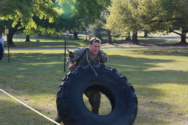 FORT BENNING, Ga. (April 13, 2018) -- First Lt. Deaven Miller, Team 1 of the 1st Infantry Division, flips a tire at York Field. On the first day of the 2018 Best Ranger Competition, 51 teams of two Ranger-qualified U.S. military service members took on several events to test their physical endurance, mental acumen, and technical and tactical skills. The 35th David E. Grange Jr. Best Ranger Competition, an annual competition organized by the Airborne and Ranger Training Battalion, is set to determine the most elite Ranger-qualified two-athlete team of the Armed Services April 13 through 15 at Fort Benning, Georgia. (U.S. Army photo by Markeith Horace, Maneuver Center of Excellence, Fort Benning Public Affairs Office)